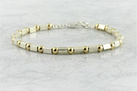 Gold and silver stamp bracelet | Image 1