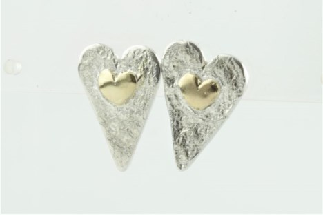 Gold and silver heart earrings | Image 1
