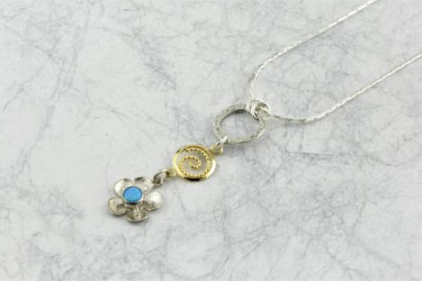 Gold and silver flower pendant with blue opal | Image 1