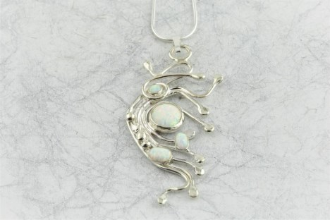 Wavy silver pendant with white opals | Image 1